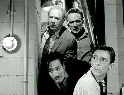 The neighbors breakthrough in Rod Serling's 'The Shelter' epsiode of The Twilight Zone, first broadcast September 29, 1961